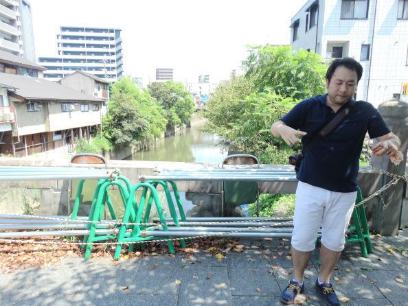 古町地区を流れる坪井川。右端は吉野新町・古町復興プロジェクト事務局長